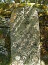 Old gravestone propped against wall  by Sylvina Tilbury  © Highland Council
