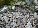 Site 1. Wooden conduit partially buried downstream of stone pier . From SE .  by Catherine Dagg  © Catherine Dagg