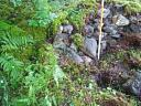 Cairn partially dismantled - west side  by Harry Robinson  © Highland Heritage