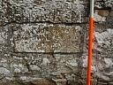 Inscribed stone in south side of churchyard wall  by Pete Higgins  © Archaeology North