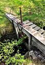 Sluice gate where fish ladder meets Abhainn an t-Sratha Charnaig  by Andrew Puls  © Highland Council